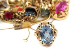 Golden luxury jewelry Stock Images