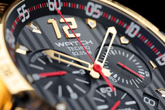 Golden, luxury men's wristwatch. Clock face close up. Royalty Free Stock Images