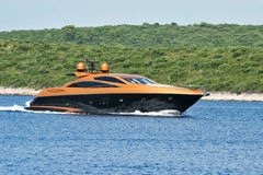 Golden Luxury Yacht. Cruising in the Blue Sea royalty free stock photos