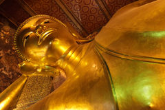 Golden lying buddha Stock Photography