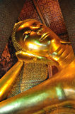 The golden lying buddha in Wat Pho. Bangkok thailand Royalty Free Stock Photography