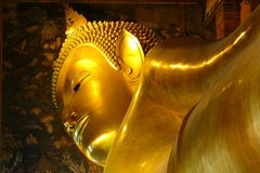 Golden Lying Buddha in Wat-Pho temple, Bangkok, Thailand Stock Images