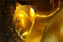 Golden Lying Buddha in Wat-Pho temple, Bangkok, Thailand Stock Images