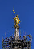 The Golden Madonnina on the roof of Duomo Cathedral, Milan, Italy stock image