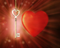 Golden magic glowing key on background with a heart. Stock Images