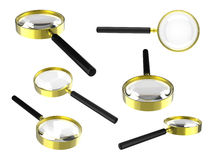 Golden magnifying glass Royalty Free Stock Photos