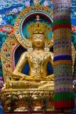 Golden Maitreya. A large gilded deity of the Buddhist personality Maitreya Stock Photography