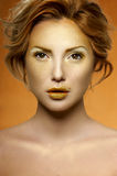 Golden Makeup on Face of fashion beauty Female Model Stock Images