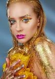 Golden makeup stock image