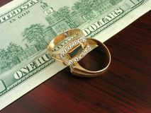 Golden male rings and dollars royalty free stock photography