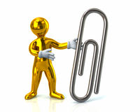 Golden man and silver paper clip Royalty Free Stock Photos