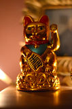 Golden Maneki Neko, the Lucky Cat. A Golden Maneki Neko, the Lucky Cat for fortune and money royalty free stock photo