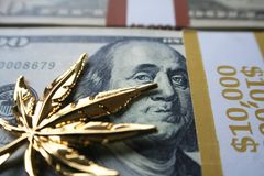 Golden Marijuana Leaf On Hundreds High Quality. Golden Marijuana Leaf On Hundred Dollar Bills High Quality Stock Photo royalty free stock photography