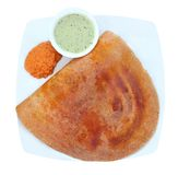 Golden masala dosa with two different chutneys Stock Photos