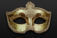 Golden mask. Artistic golden mask over a dark background royalty free stock photos
