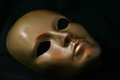 Golden Mask. Gold Mask against black background royalty free stock photos