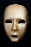 Golden mask. Image golden carnival mask isolated on black background Royalty Free Stock Image