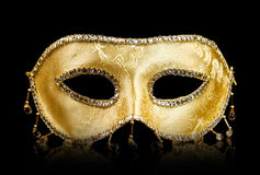 Golden mask on black Royalty Free Stock Photos