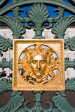 Golden mask on fence - Royal Palace - Turin Italy Royalty Free Stock Photos