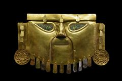 Ancient Peruvian Mask made of Gold. Golden Mask of the Peruvian Lords. Lambayeque - Chimu Jewellery. Commonly used in a funeral of Incan Lords Royalty Free Stock Image