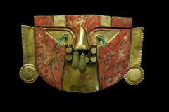 Ancient Peruvian Mask made of Gold. Golden Mask of the Peruvian Lords. Lambayeque - Chimu Jewellery. Commonly used in a funeral of Incan Lords Stock Image