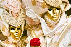 Golden mask with Red rose. royalty free stock photo