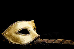 Golden mask with ribbon and pearls Stock Photo
