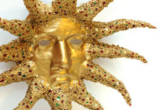 Golden mask of sun. Decorated with tinsel Stock Photos