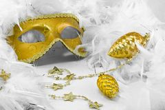 Golden mask and two bauble. In white feathers boa Royalty Free Stock Images