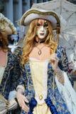 Golden mask with umbrella, Venice, Italy, Europe royalty free stock photo