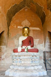 Golden masked ancient Buddha statue at Htilo Minlo Pagoda. Royalty Free Stock Photo