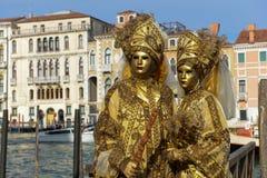 Golden Masked couple Stock Image
