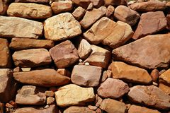 Golden masonry stone wall from old building Royalty Free Stock Photography