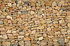 Golden masonry stone wall from old building Stock Photos