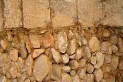 Golden masonry stone wall from old building Royalty Free Stock Images