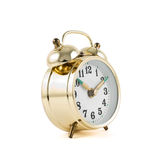 Golden mechanical alarm clock isolated. Traditional wind-up keywound, spring-driven mechanical golden alarm clock isolated over white background Royalty Free Stock Photo