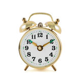 Golden mechanical alarm clock isolated Stock Photo