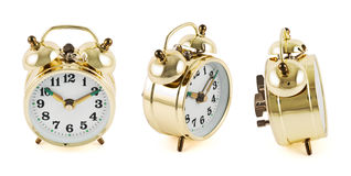 Golden mechanical alarm clock isolated Royalty Free Stock Photography