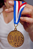 Golden medal. A worlds best lover medal is being shown by a woman Stock Image