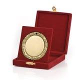 Golden medal. In a red velvet box on white background royalty free stock photo