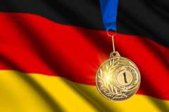 Golden medal against German flag background Stock Photo