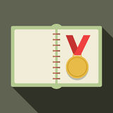 Golden Medal In A Book Royalty Free Stock Photo