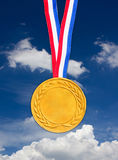 Golden Medal. Golden Medal In Front Of Blue Sky Stock Photography