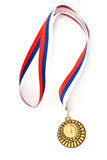Golden medal isolated on white stock images