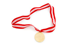 Golden medal isolated on the white. Background Royalty Free Stock Photo
