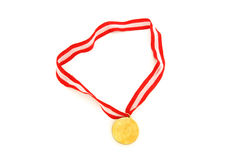Golden medal isolated on the white Stock Photos