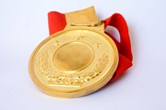 Golden medal isolated on white Royalty Free Stock Photo