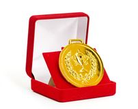 Golden medal in red gift box. White background Royalty Free Stock Photos