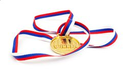Golden medal and ribbon Stock Image