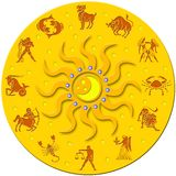 Golden medal with signs of the zodiac. Decorative round golden badge with a plastic sun with colored balls and the signs of the zodiac around Royalty Free Stock Image